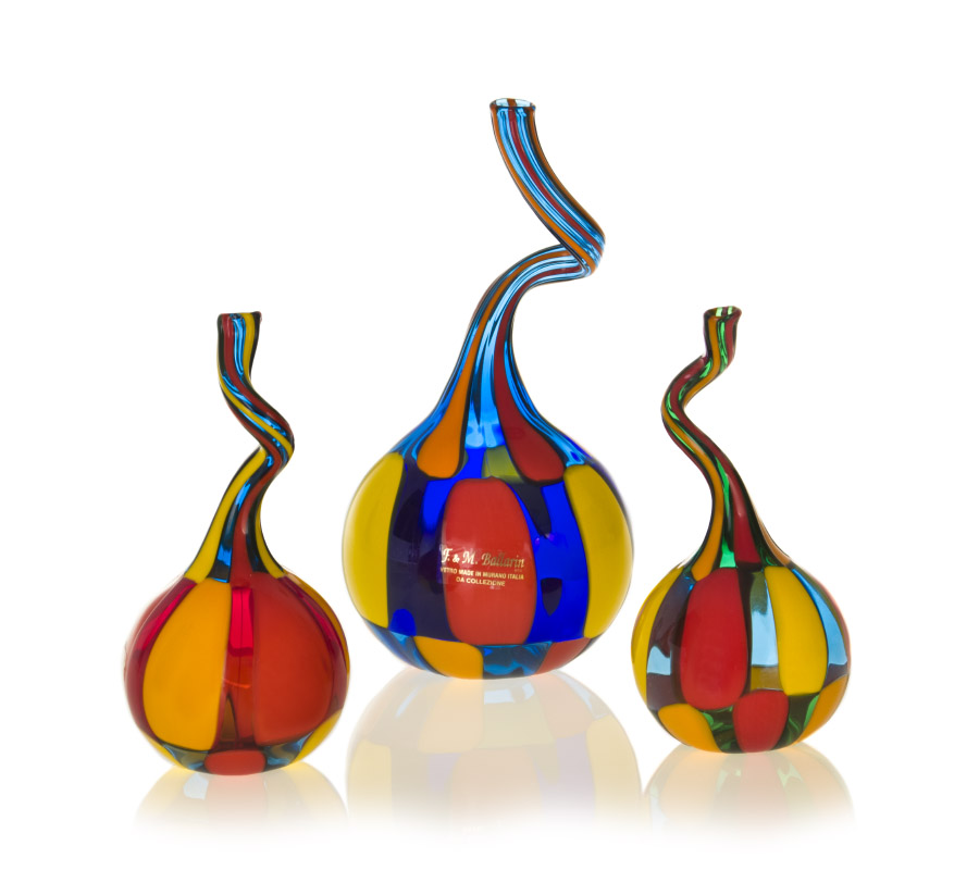 a glass pezzato set of twisted bottles