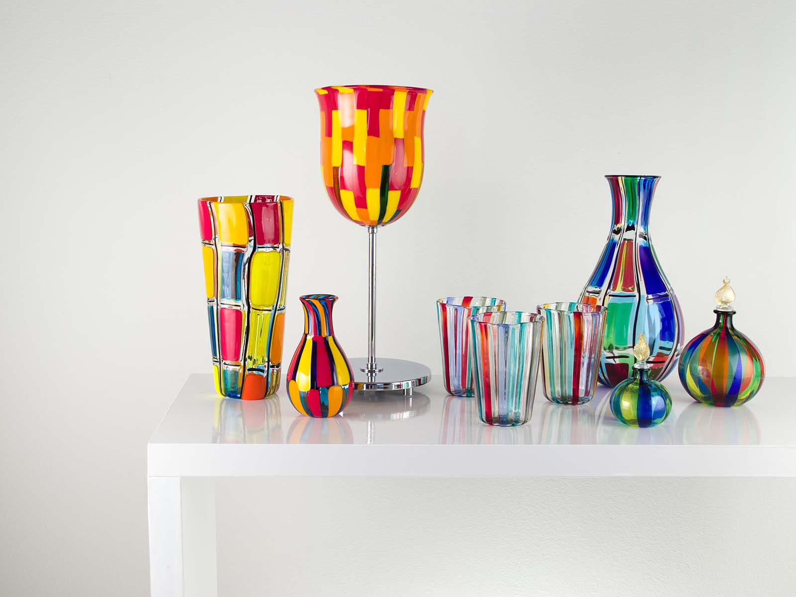 a group of murano glass on the table